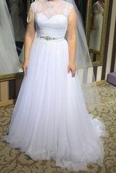 Великолепное свадебное платье.